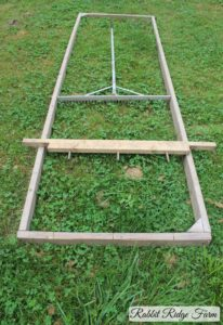 Our frame, marking board, and large garden rake.